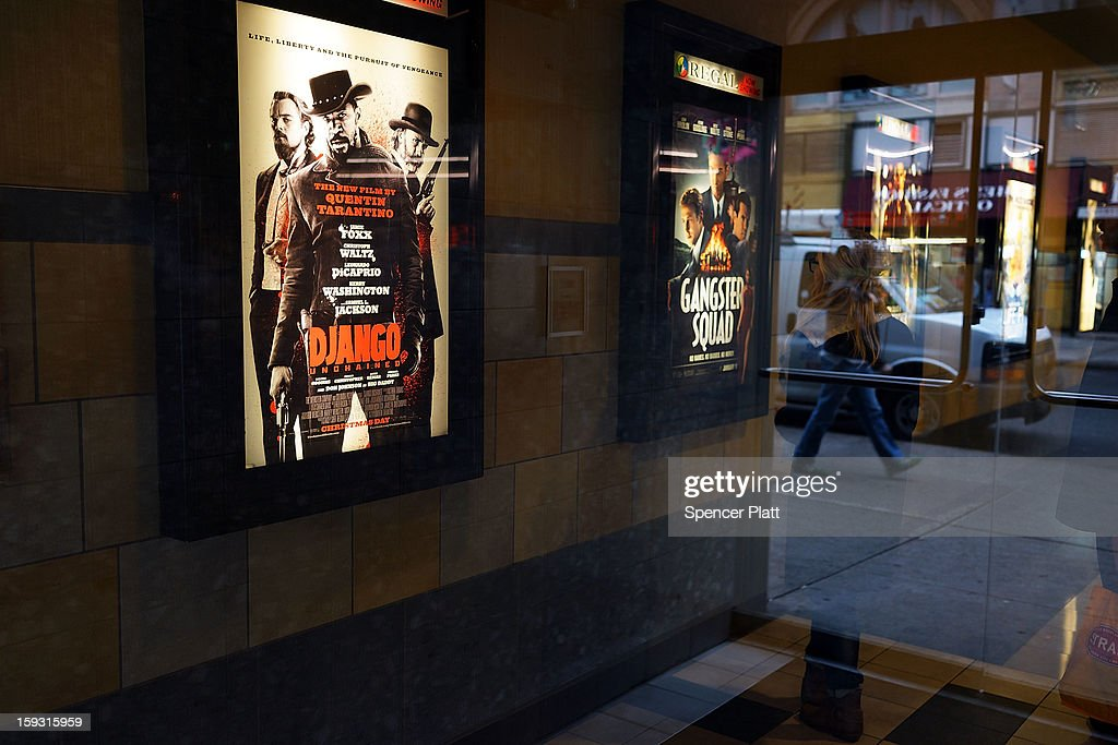 A poster advertises a new film by Quentin Tarantino which has been criticized for excessive violence at a movie theater on January 11, 2013 in New York City. Following the shootings of children at a elementary school last month in Connecticut, numerous politicians and activists have begun to focus on violence in video games and films. US vice-president Joe Biden is meeting with games industry representatives today to discuss graphic violence, often with guns, in many of today's most popular video games. The administration is also expected to address violence in the film industry as well.