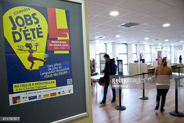 A poster advertises summer jobs as jobseekers queue inside a Pole Emploi job center the French national employment agency in Montpellier France on...