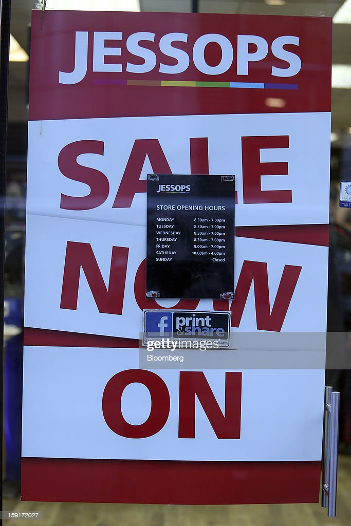 A poster advertising a sale sits on display inside the glass entrance door of a Jessops camera store in London, U.K., on Wednesday, Jan. 9, 2013. PricewaterhouseCoopers LLC were today appointed administrators of U.K. camera retailer The Jessop Group Ltd. Photographer: Chris Ratcliffe/Bloomberg via Getty Images