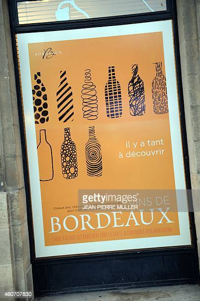 A poster advertising Bordeaux wines is seen posted outside a wine bar which supports the CIVB on December 19 in the city of Bordeaux French Bordeaux...