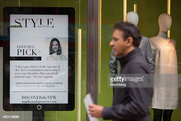 A poster advertising MS's clothing range stands in the window display of a Marks Spencer retail store operated by Marks Spencer Group Plc in London...