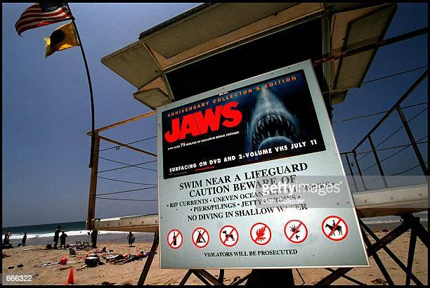 A poster advertising the anniversary collector's edition of the movie 'Jaws' is posted on a lifeguard tower June 2 2000 on Zuma Beach in Malibu CA...