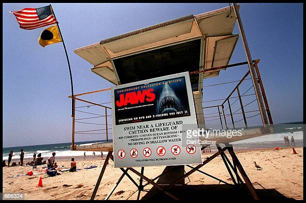 A poster advertising the anniversary collector's edition of the movie 'Jaws' is posted on a lifeguard tower July 2 2000 on Zuma Beach in Malibu CA...