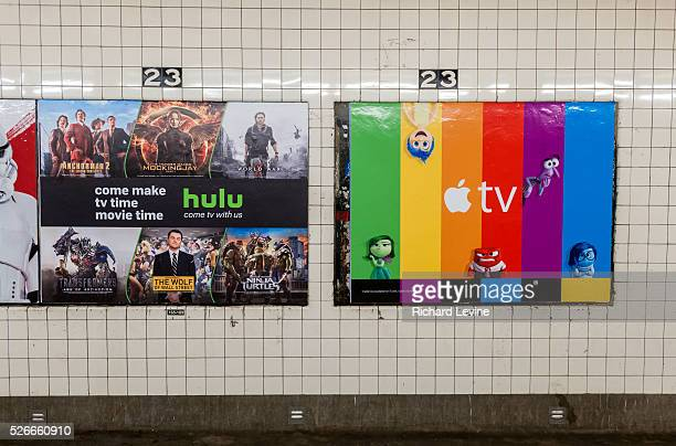 A poster advertising the AppleTV streaming video product next to a Hulu ad in the subway in New York