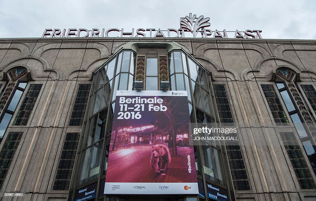 A poster advertising the Berlinale Film Festival hangs on the facade of the Friedrichstadt Palast theatre in Berlin on February 8, 2016. Movies starring Colin Firth, Kirsten Dunst and Emma Thompson will vie for gold at the 66th Berlin film festival starting February 11, with Meryl Streep as jury president and a spotlight on Europe's refugee crisis. / AFP / John MACDOUGALL