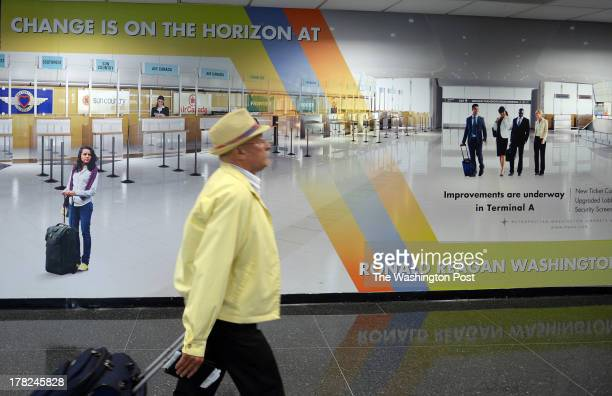 A poster advertising the changes coming to the airport is placed inside the hallways leading to Terminal A at Ronald Reagan Washington National...