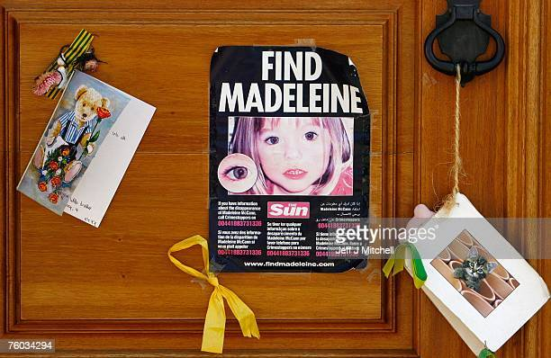 A poster and cards are placed on the Church door in Praia da Luz for missing Madeleine McCann August 9 2007 in Praia da Luz Portugal Police continue...
