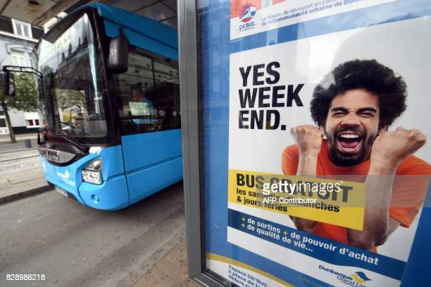 A poster at a bus stop advertises a free bus service on weekends and national holidays in the northern city of Dunkerque on July 23 2017 / AFP PHOTO...