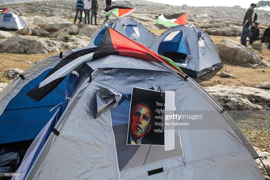 MA'ALE, ADUMIM, WEST-BANK - MARCH 20: A poster bearing an image of U.S. President <a gi-track='captionPersonalityLinkClicked' href=/galleries/search?phrase=Barack+Obama&family=editorial&specificpeople=203260 ng-click='$event.stopPropagation()'>Barack Obama</a> is posted on a tent as Palestinians erect protest tents in a camp on March 20, 2013 in the E1 area next to Ma'ale Adumim. The action took place at the same time as U.S. President <a gi-track='captionPersonalityLinkClicked' href=/galleries/search?phrase=Barack+Obama&family=editorial&specificpeople=203260 ng-click='$event.stopPropagation()'>Barack Obama</a> arrived to Ben Gurion airport near Tel Aviv. This will be Obama's first visit as President to the region, and his itinerary will include meetings with the Palestinian and Israeli leaders as well as a visit to the Church of the Nativity in Bethlehem.