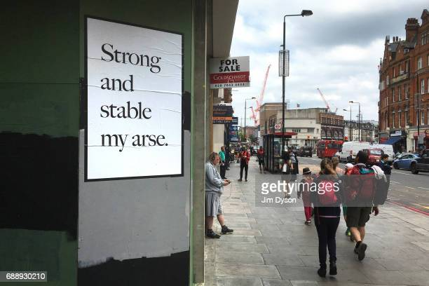 A poster by artist Jeremy Deller in response to Prime Minister Theresa May is pasted onto a wall in Camden May 27 2017 in London England Britain goes...