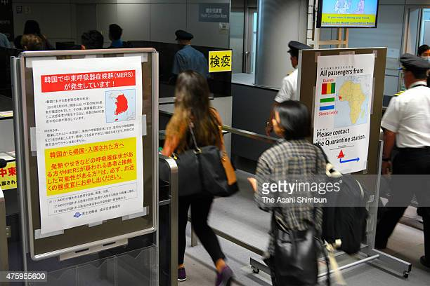 A poster calling for caution on the Middle East Respiratory Syndrome virus is placed at a quarantine of Narita International Airport on June 4 2015...