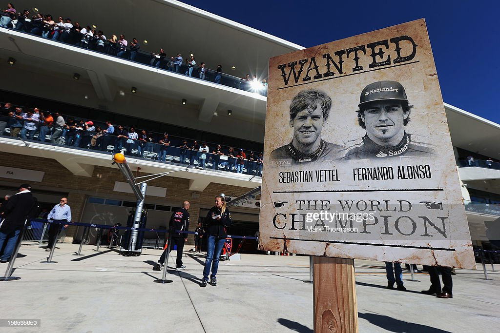 Poster depicting Sebastian Vettel of Germany and Red Bull Racing and Fernando Alonso of Spain and Ferrari is seen in the pitlane following qualifying for the United States Formula One Grand Prix at the Circuit of the Americas on November 17, 2012 in Austin, Texas.