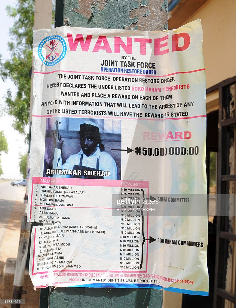 A poster displayed along the road shows photograph of Imam Abubakar Shekau, leader of the militant Islamist group Boko Haram, declared wanted by the Nigerian military with $320,471 reward for information that could lead to his capture in northeastern Nigeria town of Maiduguri May 1, 2013. Abubakar Shekau, leader of Islamist sect that has killed about 4,000 people since 2009 when it began its campaign of terror is Nigeria's most wanted man, who has been designated a terrorist by the US government. President Goodluck Jonathan has approved the constitution of a Presidential Committee to constructively engage key members of Boko Haram and define a comprehensive and workable framework for resolving the crisis of insecurity in the country.