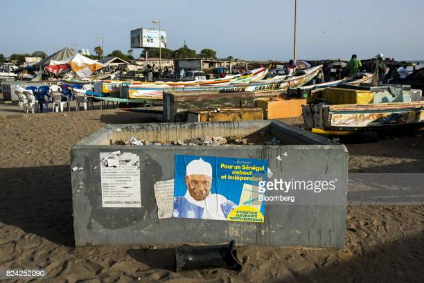A poster displaying Abdoulaye Wade leader of the Senegalese Democratic Party sits on a container at the Soumbedioune fish market in Dakar Senegal on...