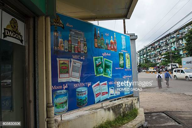 A poster displays beer liquor beverage rice sugar milk and bottled water products made by the Myanmar Economic Cooperation one of the country's main...