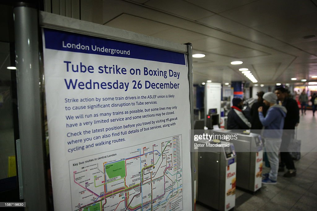 A poster explains the underground network strike action to passengers at Oxford Circus on December 26, 2012 in London, England. Thousands of shoppers are in London looking for a bargain in the traditional Boxing Day sales. Shoppers also faced disruptions due to striking London Underground drivers.