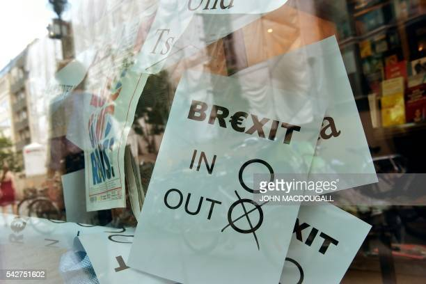 A poster featuring a Brexit vote ballot with 'out' tagged is on display at a book shop window in Berlin on June 24 2016 Britain has voted to break...