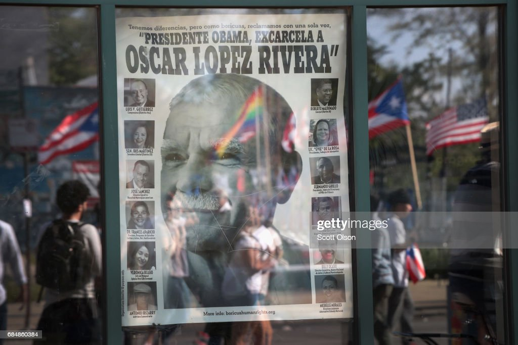 A poster featuring Puerto Rican nationalist Oscar López Rivera is posted in a window in the Humboldt Park neighborhood as Lopez and his supporters march by on the way to a rally organized in his honor on May 18, 2017 in Chicago, Illinois. López, who once lived in Chicago was released from federal custody yesterday, his prison sentence being commuted by President Barack Obama before he left office. Lopez was one of the leaders of the Armed Forces of National Liberation (FALN), a Puerto Rican group that claimed responsibility for more than 100 bombings at government buildings, department stores, banks and restaurants in New York, Chicago, Washington D.C. and Puerto Rico during the 1970s and early 1980s.