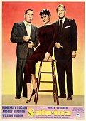 A poster for Billy Wilder's 1954 comedy 'Sabrina' starring Humphrey Bogart Audrey Hepburn and William Holden