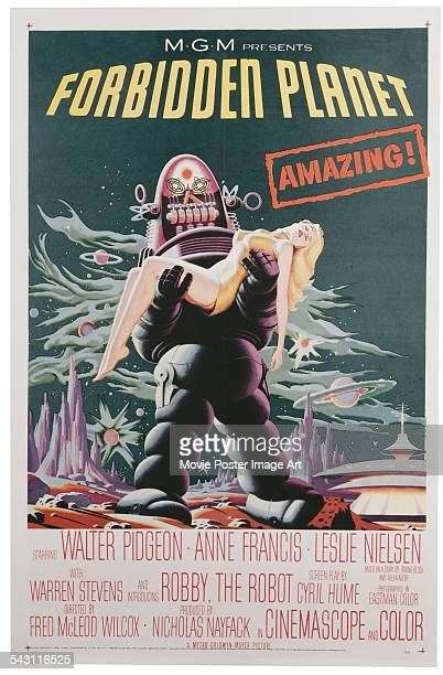 A poster for Fred M Wilcox's 1956 science fiction film 'Forbidden Planet' featuring Robby the Robot and Anne Francis