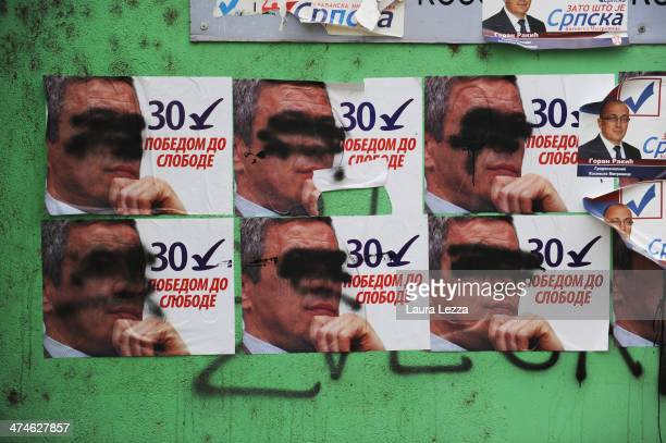 A poster for mayoral candidates Milan Ivanovic on display outside a polling station few days before the elections day in Mitrovica North to elect the...