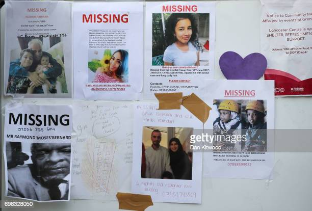 Poster for missing people are seen on a wall near Grenfell Tower on June 15 2017 in London England At least 17 people have been confirmed dead and...