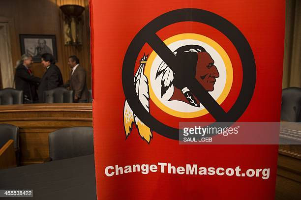 A poster for the 'Change the Mascot' campaign is seen prior to a press conference by the Oneida Indian Nation leaders on Capitol Hill in Washington...