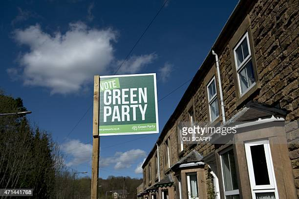 A poster for the Green Party is displayed outside a home in the 'Derbyshire Dales' parliamentary constituency in Wirksworth Derbyshire northern...