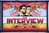A poster for 'The Interview' is displayed on the marquee of the Los Feliz 3 cinema December 25 2014 in Los Angeles California Some two hundred US...