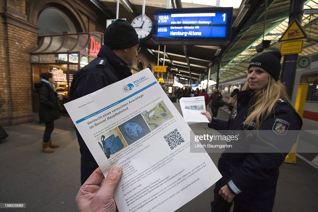 A poster handed out by the police shows the suspect of an attempted bomb attack at Bonn central train station on December 13, 2012 in Bonn, Germany. German police have begun searching for a second suspect they believe was behind a bomb scare in the western city of Bonn. The local police had expanded their search after spotting a potential suspect on video footage from a nearby fastfood restaurant.