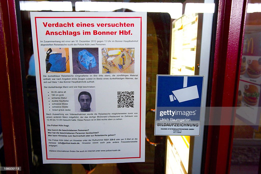A poster handed out by the police shows the suspect of an attempted bomb attack as it is displayed at Bonn central train station on December 13, 2012 in Bonn, Germany. German police have begun searching for a second suspect they believe was behind a bomb scare in the western city of Bonn. The local police had expanded their search after spotting a potential suspect on video footage from a nearby fastfood restaurant.