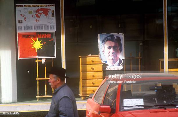 A poster hanging on the window of a shop in Visegrad It portrays Radovan Karadzic former president of the Serbian Republic of Bosnia and Herzegovina...