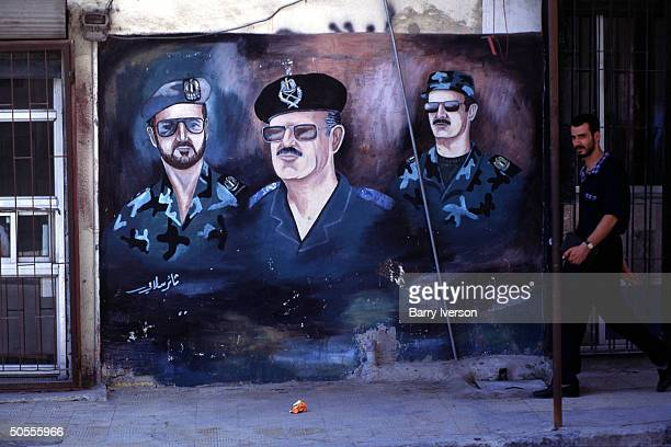 Poster imaging Syrian Pres Hafez Assad flanked by his 2 sons Basil his oldest who died in 1994 car crash Bashar hischosen successor