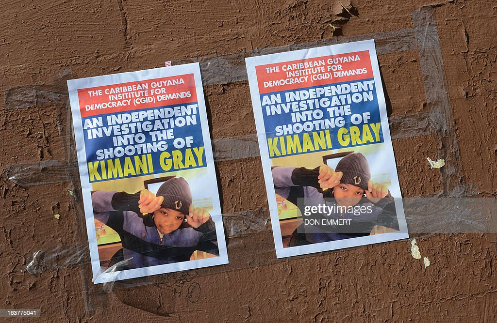 Poster in memory of Kimani Gray hang on a building wall at a memorial for the 16-year-old boy March 15, 2013 in New York. Kimani Gray was shot by two police officers late on Saturday in Brooklyn's East Flatbush neighborhood after police said he pointed a handgun at them. An autopsy revealed that Gray had been shot seven times, including three times in the back. Although the report did not detail the order in which the bullets struck Gray, the revelations increased tensions among the already furious community.