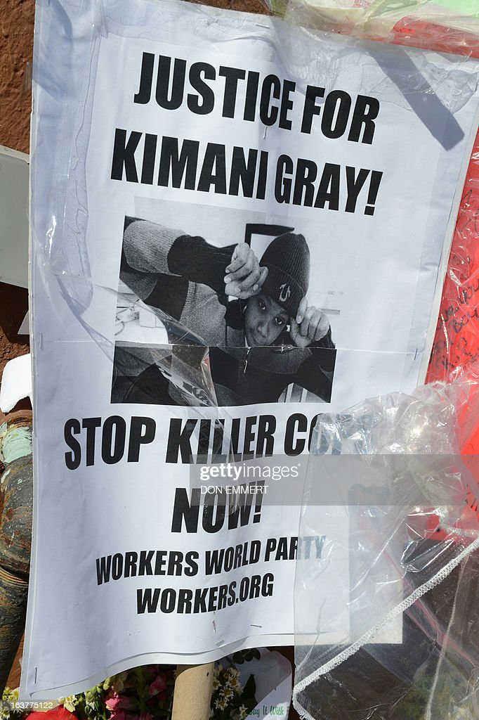 A poster in memory of Kimani Gray is part of a memorial for the 16-year-old boy March 15, 2013 in New York. Kimani Gray was shot by two police officers late on Saturday in Brooklyn's East Flatbush neighborhood after police said he pointed a handgun at them. An autopsy revealed that Gray had been shot seven times, including three times in the back. Although the report did not detail the order in which the bullets struck Gray, the revelations increased tensions among the already furious community.