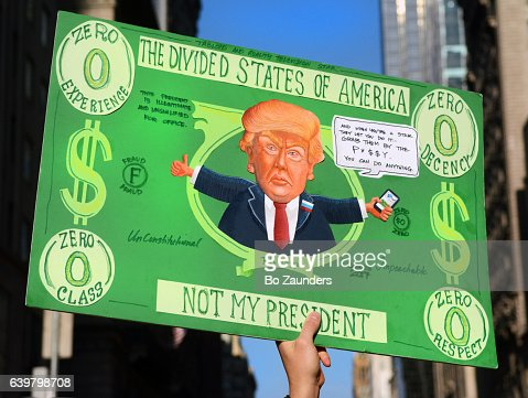 poster in the shape of a zero $ bill, at the Women's March rally : Stock Photo