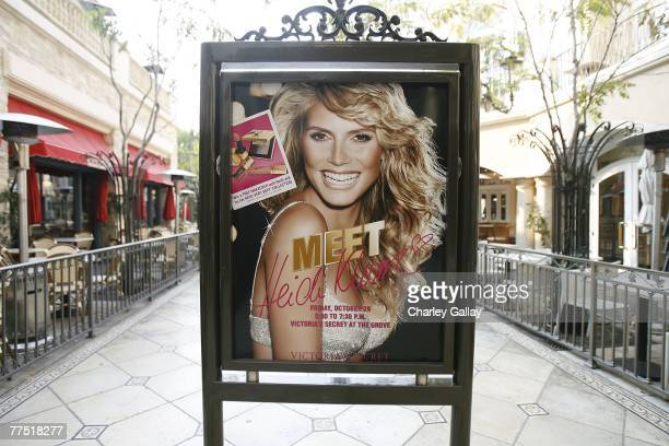 A poster is displayed as model Heidi Klum launches her signature makeup collection at the Victoria's Secret store at The Grove October 26 2007 in Los...
