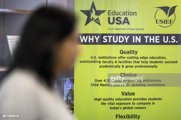 A poster is displayed at the United StatesIndia Education Foundation in Mumbai India on Wednesday March 8 2017 For decades the US has lured thousands...