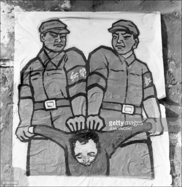 A poster is displayed in late 1966 in Beijing's street featuring how to deal with socalled 'enemy of the people' during the Great Proletarian...
