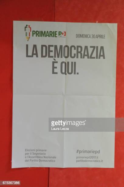 poster is displayed while former Italian Prime Minister and PD secretary Matteo Renzi casts his vote for Democratic Party leadership primaries on...