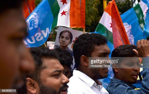 A poster of Anitha peeps through the flags as NSUI activists staged a demonstration in demand of justice for Anitha and ban of NEET on September 4...