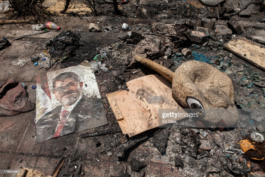 A poster of deposed Egyptian President Mohammed Morsi lies in the debris left outside the Rabaa alAdaweya Mosque in Nasr City on August 15 2013 in...