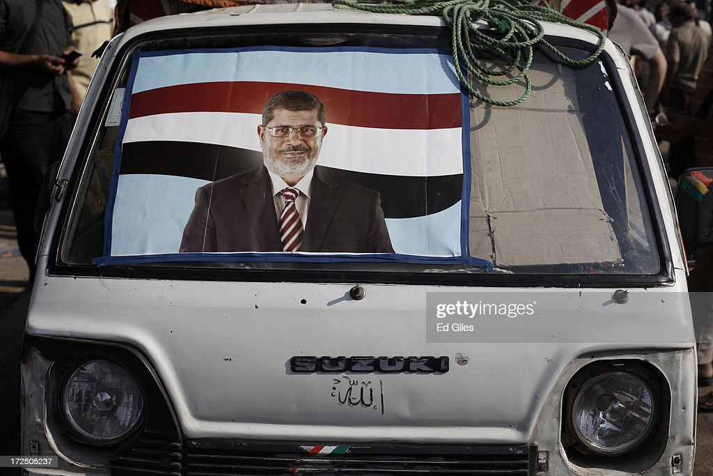 A poster of Egyptian President Mohammed Morsi adorns a van during a demonstration at the Rabaa al Adawiya Mosque in the suburb of Nasr City on July 2, 2013 in Cairo, Egypt. In a statement on July 1, the Egyptian Army asked Egyptian President Mohammed Morsi to resolve mass demonstrations against his continued rule or face intervention by the military within 48 hours. Crowds of pro- and anti-government protesters gathered in locations across Egypt on June 30, the day of a series of nation-wide mass demonstrations entitled 'Tamarod', or 'Rebel'. The 'Tamarod' campaign, organised by a coalition of opposition political groups and planned to take place on the first anniversary of Egyptian President Mohammed Morsi's election to the country's Presidency, aims to bring down the government of President Morsi through country-wide demonstrations.