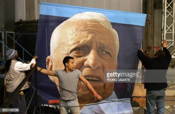 A poster of Israeli Prime Ariel Sharon who had a massive stroke 12 weeks ago is set up 27 March 2006 above the podium where acting Prime Minister...