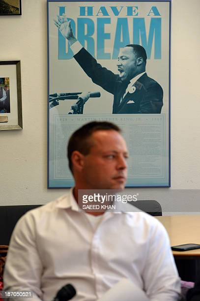 A poster of Martin Luther King Jr hangs on the wall as David Hicks once dubbed the 'Aussie Taliban' after being captured in Afghanistan and spending...