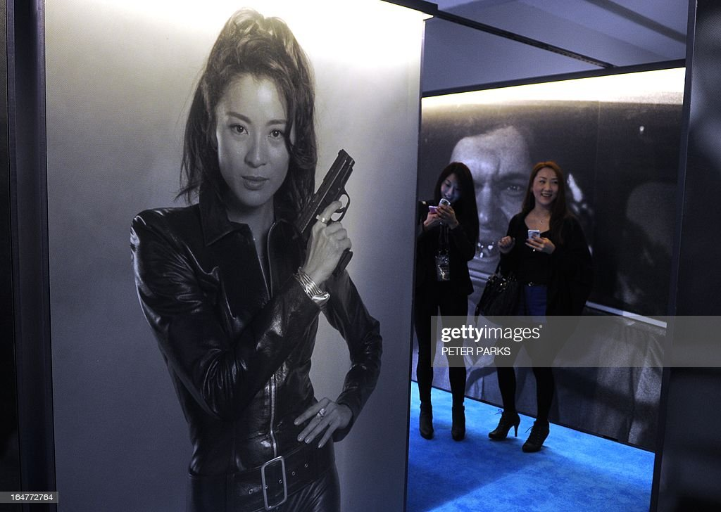A poster of Michelle Yeoh playing Chinese spy Wai Lin in the James Bond movie 'Tomorrow Never Dies' is seen at an exhibition on the fictional British spy in Shanghai on March 28, 2013. The exhibition opened in Shanghai just weeks after the Communist government's censors cut parts of the latest film in the franchise, 'Skyfall' with a scene showing prostitution in Macau, a special administrative region of China, was removed, as was a line in which Bond's nemesis mentions being tortured by Chinese security agents. AFP PHOTO/Peter PARKS