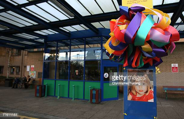 A poster of missing child Madeleine McCann adorns the entrance to Glenfield Hospital where her father Gerry McCann a consultant cardiologist returns...