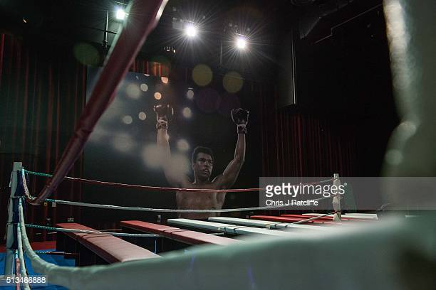 A poster of Muhammad Ali on display next to a boxing ring at the preview of the 'I Am The Greatest' Muhammad Ali exhibition on March 3 2016 in London...