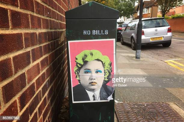 A poster of North Korean leader Kim Jong Un as Andy Warhol's Marilyn Monroe is pictured on a street in Acton on September 23 2017 in West London...