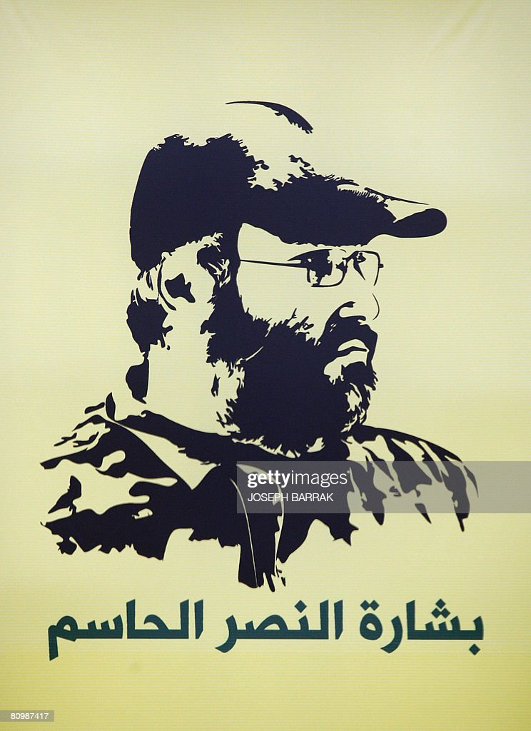 A poster of recently assassinated Hezbollah commander Imad Mughnieh is displayed at Rafiq Hariri International Airport in Beirut on March 28 2008...